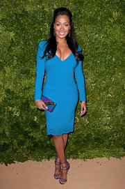 La La Anthony wore purple evening sandals with her blue dress for a color-blocked finish.