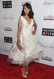 Kerry Washington accessorized her sheer layered white dress with taupe platform pumps.