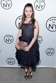 Fatima Ptacek wore a pretty black dress with a lace bodice and a ruffled skirt.