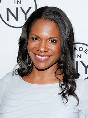 Audra McDonald kept her black tresses sleek and shiny with soft and loose waves.