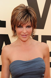 To play up her brown eyes, Lisa Rinna wore shimmering grays and silver eyeshadow along with lots of black eye pencil and black mascara.
