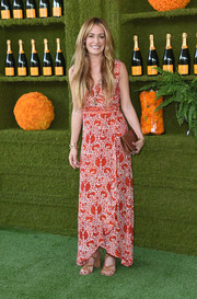 Cat Deeley was all about summertime charm in a printed maxi wrap dress by Natalie Martin at the Veuve Clicquot Polo Classic.
