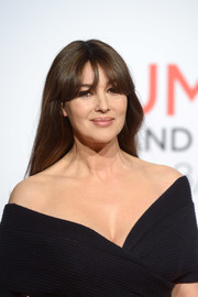 Monica Bellucci wore her hair loose with a center part and eye-grazing bangs during the Festival Lumiere opening ceremony.