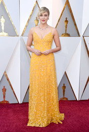 Greta Gerwig was a glamorous ray of sunshine in a beaded yellow slip gown by Rodarte at the 2018 Oscars.
