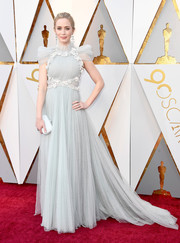 Emily Blunt complemented her dress with a pale blue clutch by Judith Leiber.