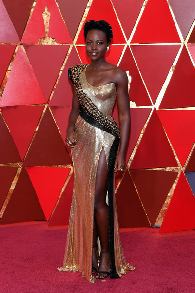Lupita Nyong'o opted for simple styling with a pair of black ankle-strap sandals by Alexandre Birman.