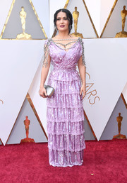 Salma Hayek channeled some '20s glamour in a lavender sequin gown by Gucci, featuring a jewel-adorned neckline and a tiered skirt, at the 2018 Oscars.