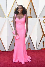 Viola Davis went ultra girly in a bubblegum-pink sequin gown by Michael Kors at the 2018 Oscars.