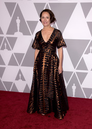 Laurie Metcalf chose a Temperley London gown, featuring a metallic print on a black background, for the 2018 Academy Awards nominees luncheon.
