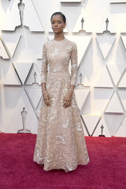 Letitia Wright kept it classy in a fully embroidered nude gown by Dior Couture at the 2019 Oscars.