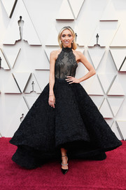 Giuliana Rancic complemented her dress with strappy evening pumps by Jimmy Choo.