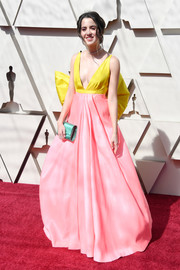 Laura Marano added an extra pop of pastel with a turquoise satin clutch.