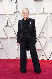 Amy Poehler went for an adrogynous vibe in a black Alberta Ferretti tuxedo at the 2019 Oscars.