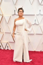 Salma Hayek looked divine in an asymmetrical white gown by Gucci at the 2020 Oscars.