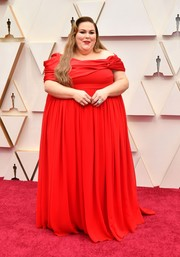 Chrissy Metz attended the 2020 Oscars wearing a custom red off-the-shoulder gown by Christian Siriano.
