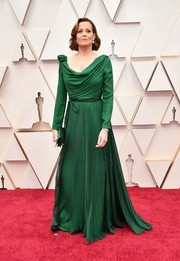 Sigourney Weaver looked regal in an emerald Dior gown with a draped bodice and a pleated skirt at the 2020 Oscars.