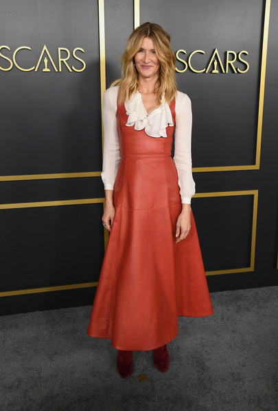 Laura Dern layered a red leather dress over a white ruffle blouse for the 2020 Oscar nominees luncheon.