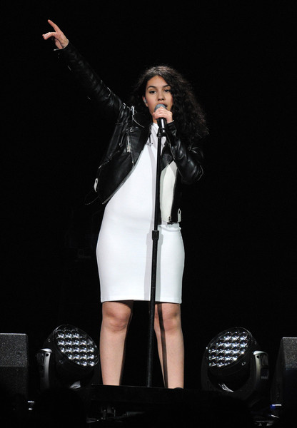 Alessia Cara donned an above-the-knee white dress to show off the singer's figure at the Jingle Ball Show.