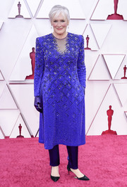 Glenn Close donned a beaded electric-blue tunic dress over a pair of silk trousers for the 2021 Oscars.