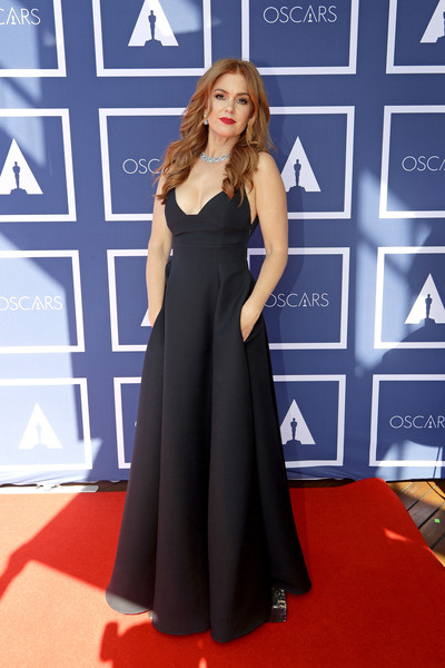 Isla Fisher kept it simple yet chic in a low-cut black gown by Dior at the 2021 Oscars.