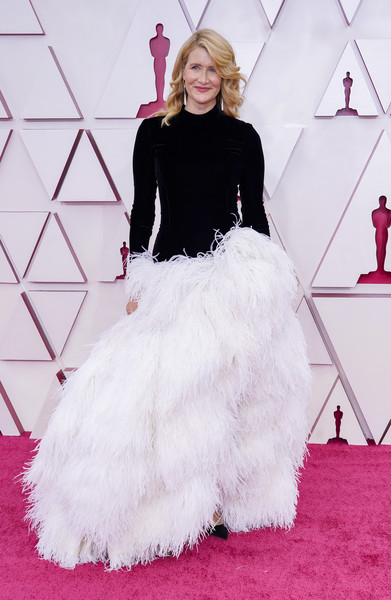 Laura Dern kept it fun in a black-and-white Oscar de la Renta gown with a velvet bodice and a feathered skirt at the 2021 Oscars.