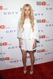 Kesha kept her styling simple with a pair of nude Casadei platform pumps.