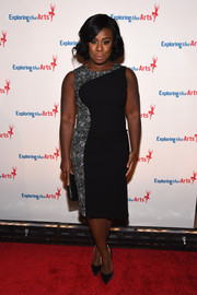 Uzo Aduba kept it classy at the Exploring the Arts Gala in a fitted black dress with a printed panel going down one side.