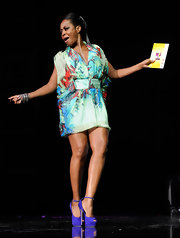 Tichina looked lovely on stage at the Hoodie Awards in colorful chiffon cocktail dress.
