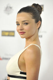 Miranda Kerr attended the 9th Annual G'Day USA Los Angeles Black Tie Gala wearing her hair in a high super-sleek bun.