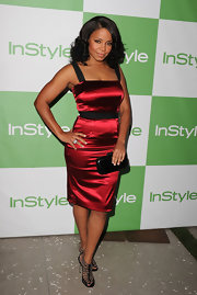 Sanaa looked amazing in a satin, curve-hugging cocktail dress with bejeweled gladiator sandals.
