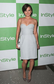 Jessica showed off her sleek style in a corset strapless dress.