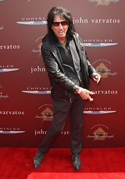 Would he really be Alice Cooper if he didn't look right at home in a leather jacket?