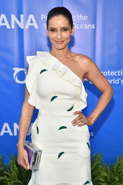 Leonor Varela attended the Oceana SeaChange Summer Party carrying a perspex box clutch with a purple pouch.