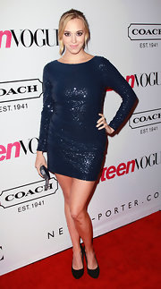 Andrew Bowen shined at the 'Teen Vogue' soiree in a midnight blue long sleeve sequined mini-dress complete with a back cut-out.