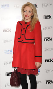 Lydia Bright looked sensational in a one-breasted red coat at 'A Night With Nick.'