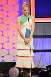 Elizabeth Banks attended the Movies for Grownups Awards wearing a fun and chic Roland Mouret color-block dress with a yoke cutout and a tiered skirt.
