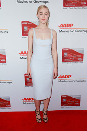Saoirse Ronan styled her dress with black multi-strap heels by Charlotte Olympia.