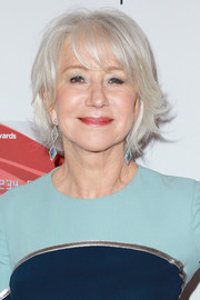 Helen Mirren complemented her dress with a pair of blue and silver gemstone drop earrings.