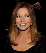 Cheryl Ladd styled her honey brown locks in a center part straight cut.