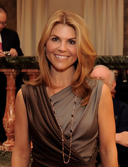 Actress Lori Loughlin wore a sleek center part hairstyle with slight waves.