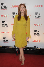 Dana Delany complemented a sunny yellow frock with feminine champagne satin pumps.