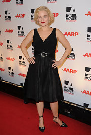 Penelope Ann Miller gave her black cocktail dress a ladylike finish with black satin pumps featuring crystal buckles and wraparound ankle straps.