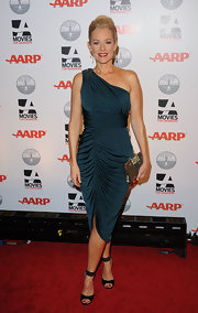 Penelope Ann Miller wore a one-shoulder turquoise dress on the red carpet of the AARP Magazine Awards.