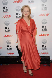 Meryl Streep looked romantic in a creamy orange silk dress for the AARP Magazine's Movies for Grownups Awards.