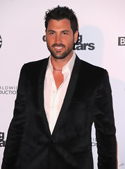 Maksim wears styles his short dark hair in this debonair 'do.