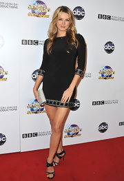 Shandi Finnessey chose a long-sleeve black frock with patterned detailing at the sleeves and hemline.
