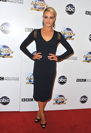 Peta rocked this sleek and slimming navy dress that featured sheer mesh panels at the sleeves.