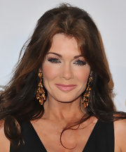 Lisa Vanderpump chose a soft blush pink lipstick to soften up her whole beauty look.