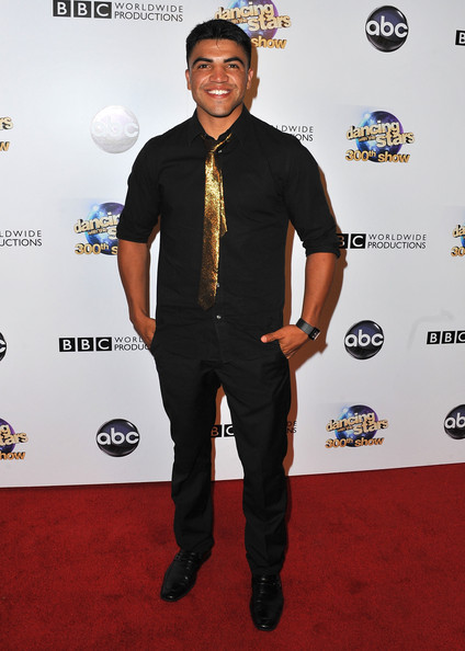 Victor Ortiz spiced up his all black look with this metallic gold tie.