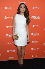 Shay Mitchell made the perfect spring selection with this white sleeveless sheath dress.